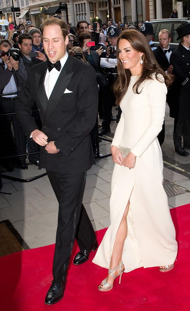 Kate shows a little leg in this sleekRoland Mouret gown.