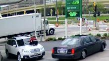 Woman stops carjacker by jumping on the bonnet of her Subaru