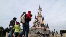 Texas Instruments Hits Chips Midday; Disney Slumps