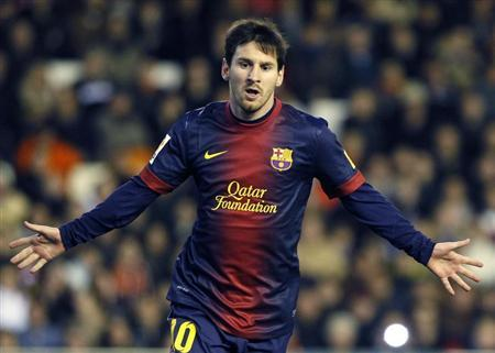 Barcelona's Messi celebrates after he scored a penalty against Valencia during their Spanish first division soccer match at the Mestalla stadium in Valencia