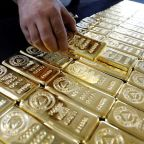 Gold firms as dollar dips after Fed minutes; palladium hits over 16-year high