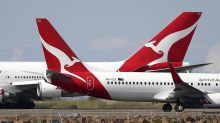 More Qantas flight cuts after travel curbs