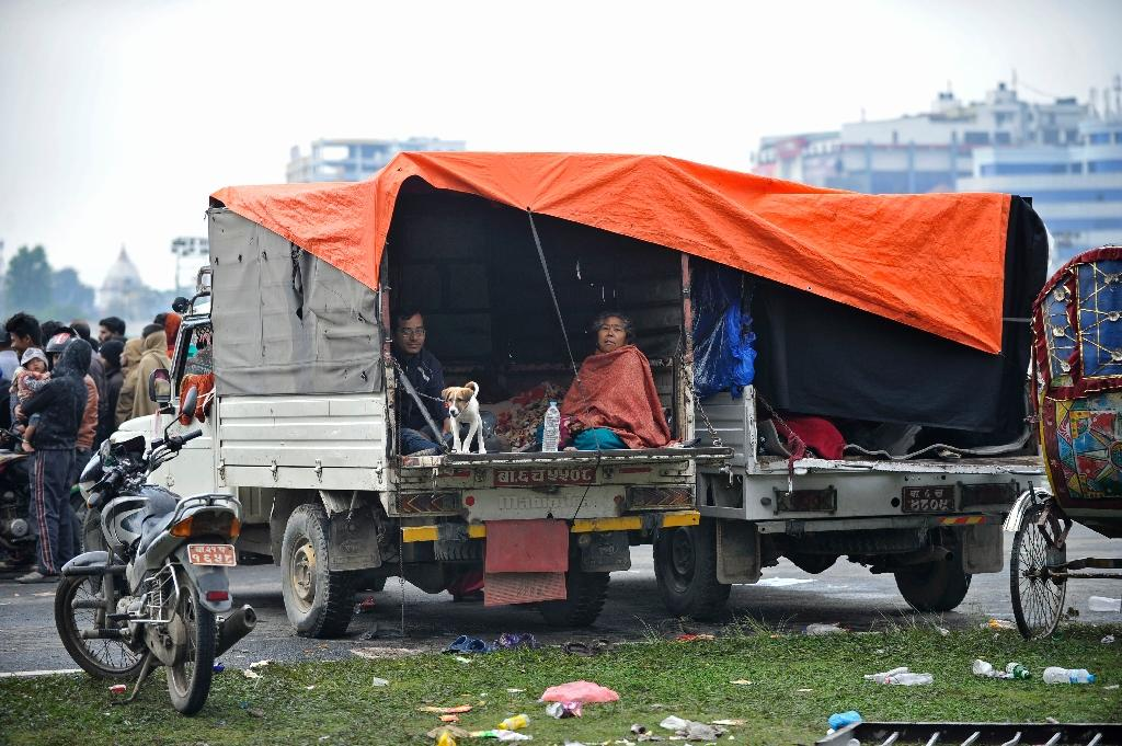 People rest in temporary shelter in open areas in Kathmandu (AFP Photo/Prakash Mathema)