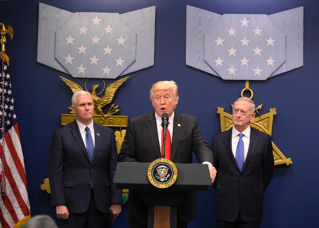 US President Donald Trump (C) speaks during the swearing-in of James Mattis (R) as secretary of defense on January 27, 2016 at the Pentagon in Washington, DC, seen with Vice President Mike Pence (L)