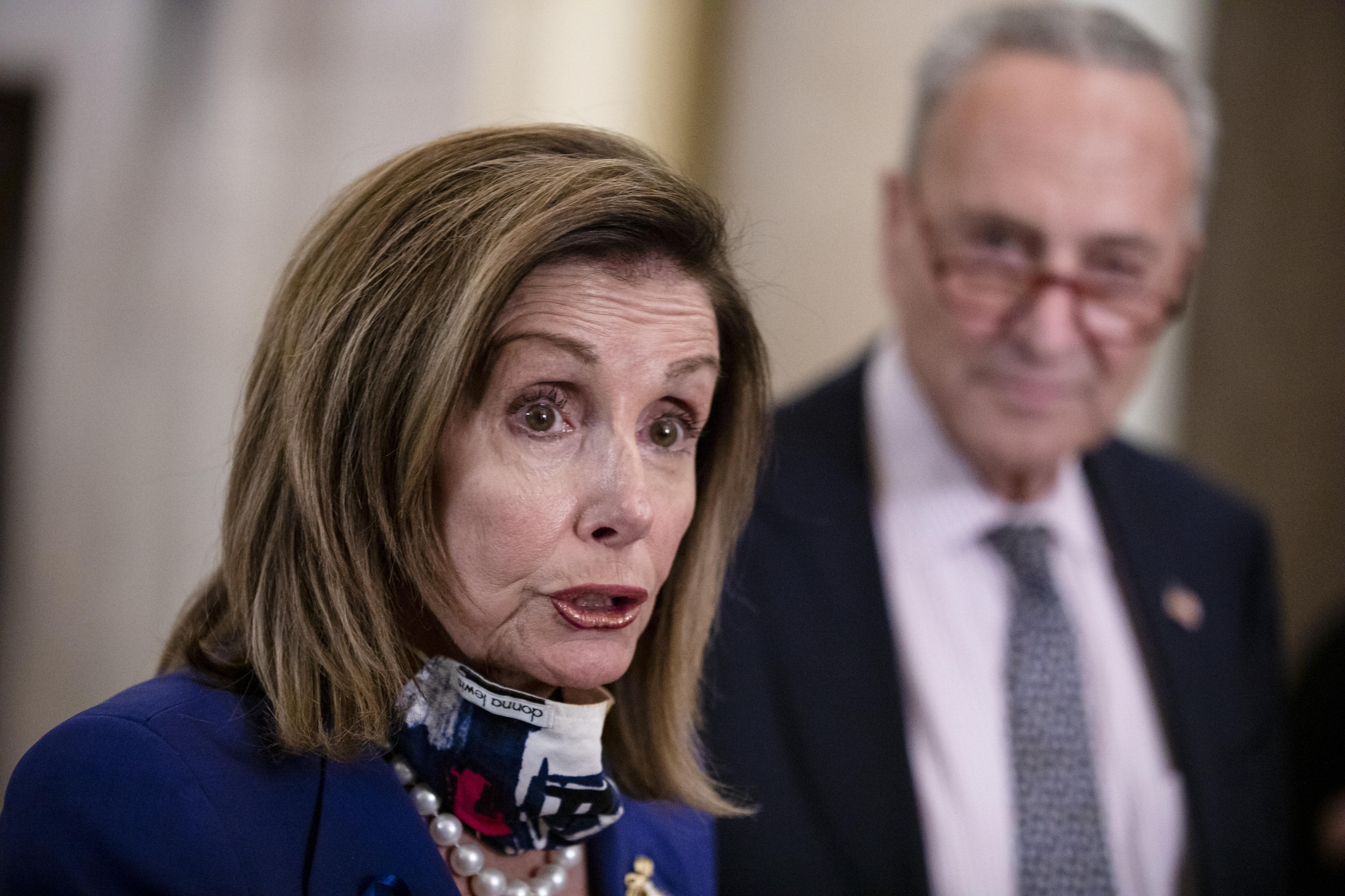 Schumer, Pelosi call on postmaster general to reverse service changes