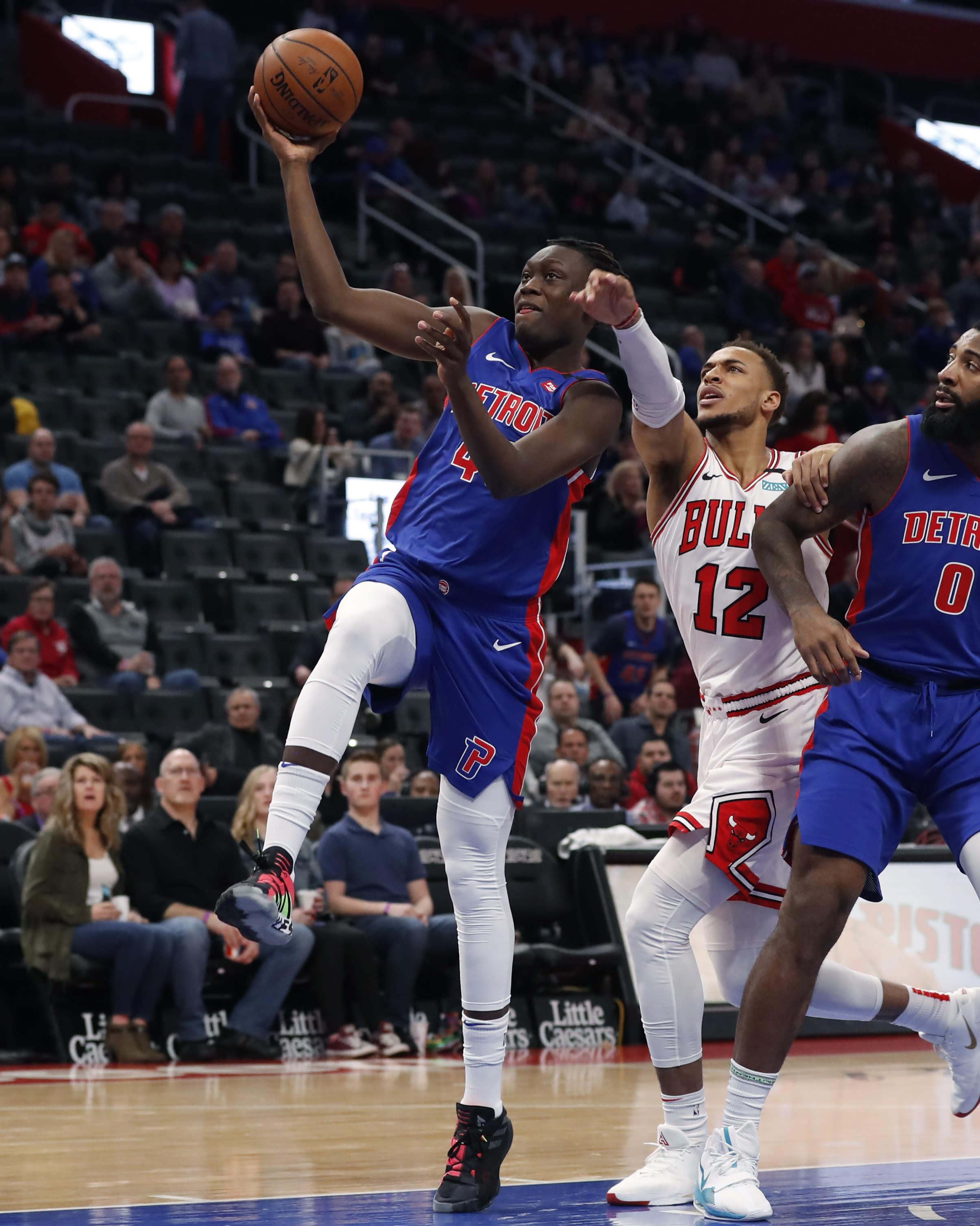 Detroit Pistons forward Sekou Doumbouya (45) makes a layup as Chicago Bulls forward Daniel Gafford (12) reaches in during the first half of an NBA basketball game, Saturday, Jan. 11, 2020, in Detroit. (AP Photo/Carlos Osorio)