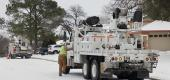 Oncor crews work to restore power to homes in Euless, Texas, on Feb. 18. (AP)