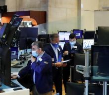 Wall Street rallies to end higher on surprise U.S. jobs report