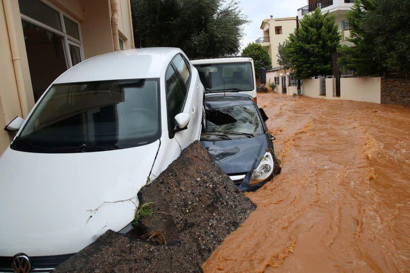 Rainstorm lashes Crete, sweeps away cars