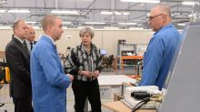 Theresa May says she still aims to reduce immigration to under 100,000
