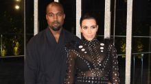 Kim Kardashian 'laying by Kanye West's side and helping to feed him' during hospitalisation