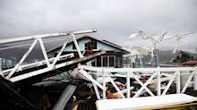 'Nature has flung her worst': Cyclone Debbie rips off roofs and flings boats onto land in Australia