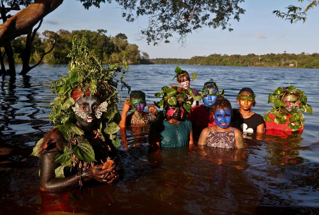As Uyra Sodoma, Emerson Munduruku tries to immerse children into a deeper understanding of nature (AFP Photo/RICARDO OLIVEIRA)