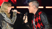 Watch Robbie Williams and Taylor Swift perform 'Angels' in London