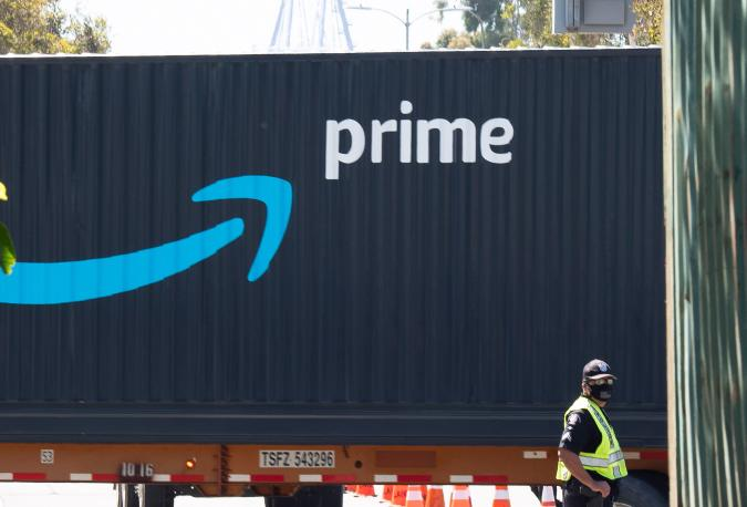 An Amazon Prime delivery truck drives through the Port of Los Angeles and Long Beach April 22, 2020 in Long Beach, California. (Photo by Robyn Beck / AFP) (Photo by ROBYN BECK/AFP via Getty Images)