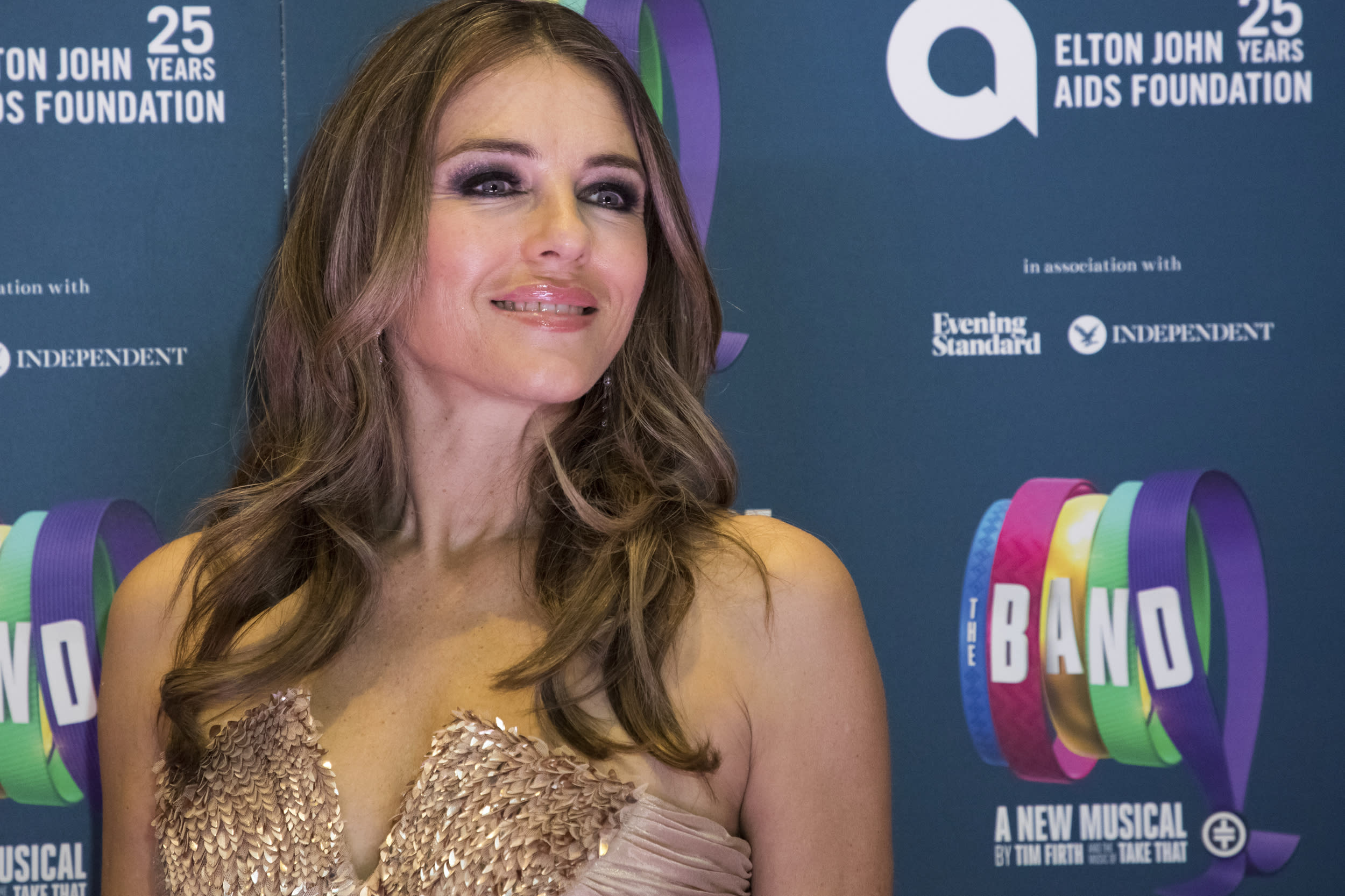 Elizabeth Hurley poses for photographers upon arrival at the premiere of the musical 'The Band', in London, Tuesday, Dec. 4, 2018. (Photo by Vianney Le Caer/Invision/AP)