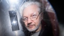 Julian Assange extradition hearing dramatically halted amid fears one of the lawyers has coronavirus