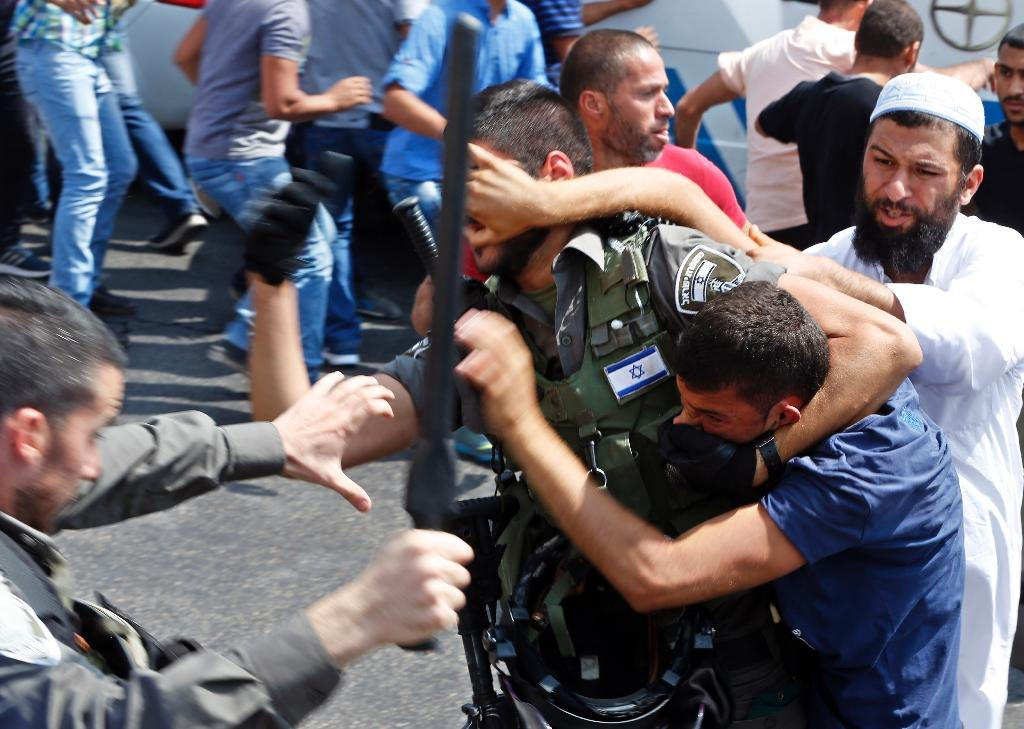 Israeli security forces clash with Palestinian protesters, who were prevented from entering the Al-Aqsa mosque compound to attend Friday prayers, on October 2, 2015, at Jerusalem's Old City Lion Gate outside the Al-Aqsa mosque compound