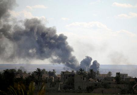 FILE PHOTO: Black plumes of smoke rise in Baghouz, Deir Al Zor province, Syria March 3, 2019. REUTERS/Rodi Said