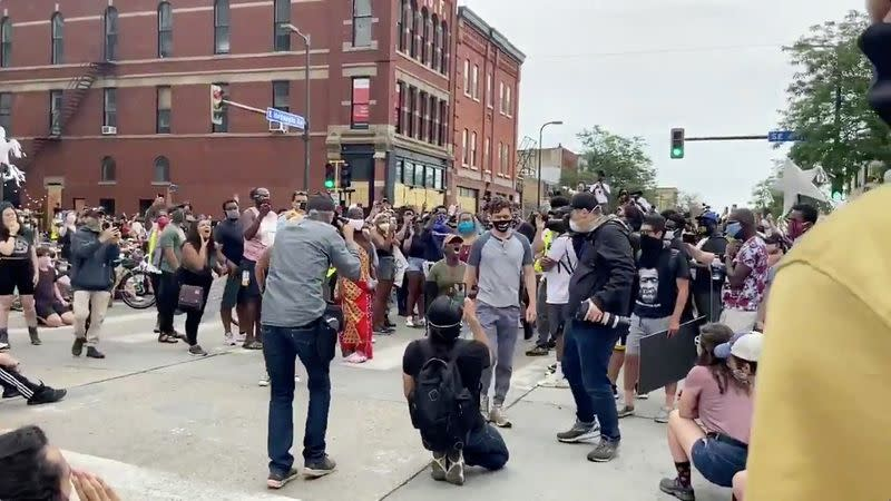 Social media video grab of Minneapolis Mayor Jacob Frey walking from a crowd of protesters, in the aftermath of the death in Minneapolis police custody of George Floyd