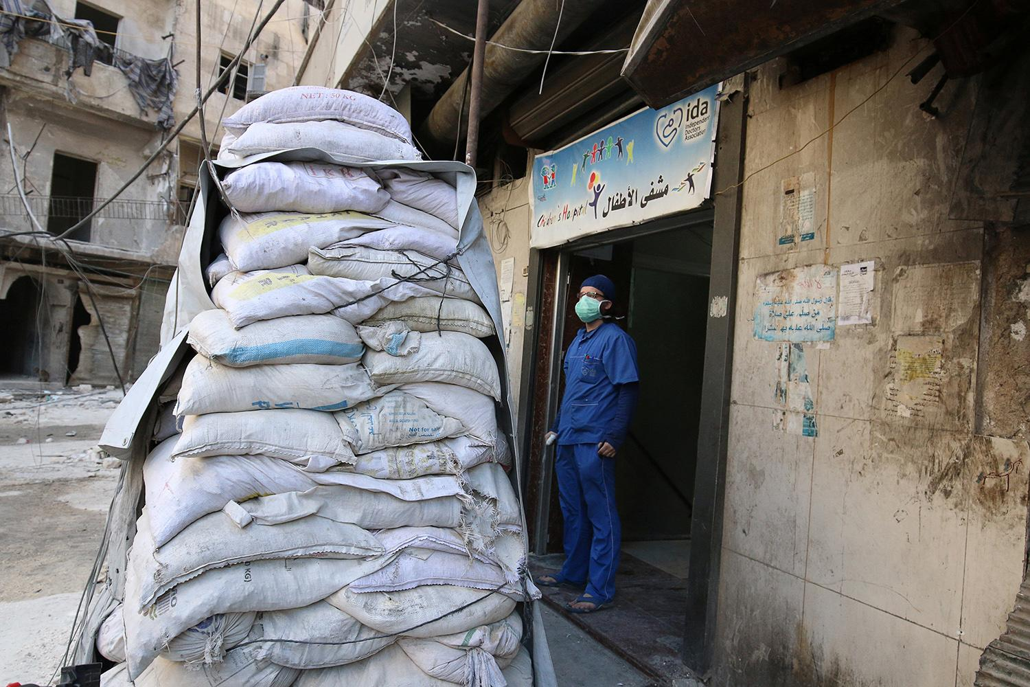<p>A medic stands behind sandbags in the damaged al-Hakeem hospital, in the rebel-held besieged area of Aleppo, Syria Nov. 19, 2016. (Photo: Abdalrhman Ismail/Reuters) </p>