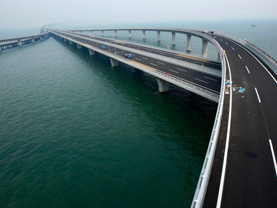 <p>Completed in 2011, China's Jiaozhou Bay Bridge is the world's longest cross-sea bridge, stretching nearly 26 miles — almost the length of a marathon. It cut travel time in half for people going between east China and the island of Huangdao. (Business Insider) </p>
