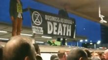Police investigate commuters who dragged Extinction Rebellion protesters off Tube train roof