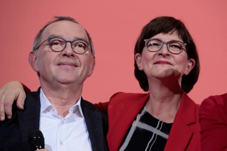 Critics of Merkel coalition win German SPD leadership vote