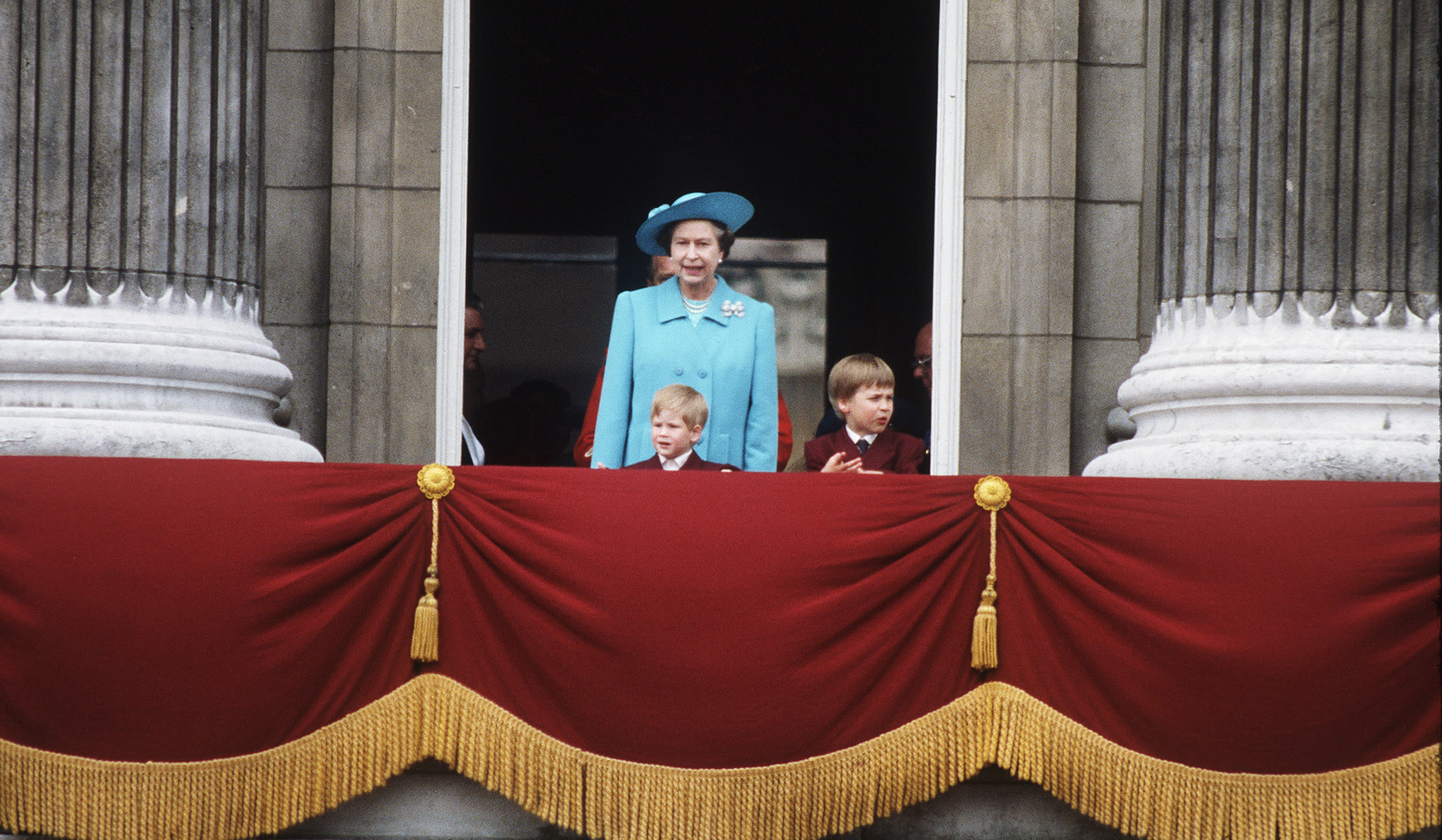 LONDON:  Queen Elizabeth II with Prince William and Prince Harry during the Tropping of the Colour ceremony at Buckingham Palace in 1988 in London, England. (Photo by Anwar Hussein/Getty Images)