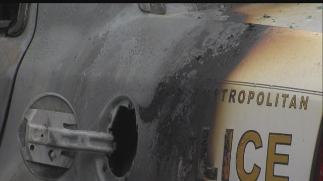 IMPD: Police car fire intentionally set