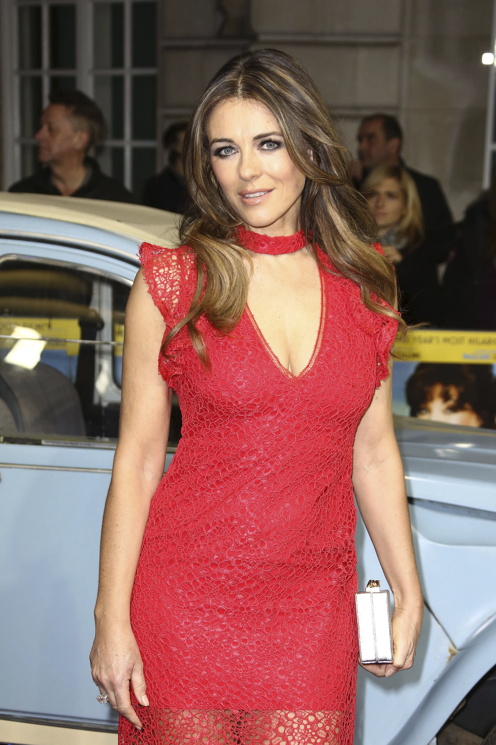 Elizabeth Hurley poses for photographers on the red carpet during the premiere for the film 'The Time of Their Lives' at a central London cinema, Wednesday, March 8, 2016. (Photo by Joel Ryan/Invision/AP)