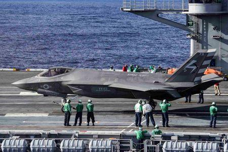 An F-35C Lightning II carrier variant joint strike fighter prepares to take off from the aircraft carrier USS Dwight D. Eisenhower in the Atlantic Ocean
