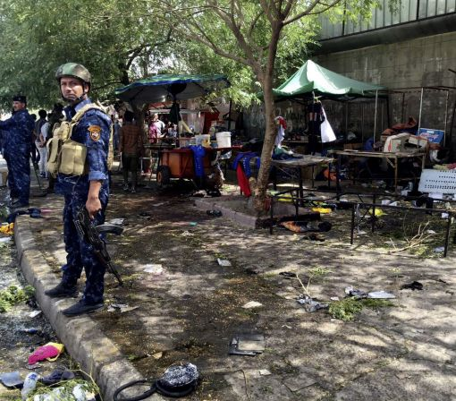 Suicide bomber kills 14 at Iraq checkpoint; 9 die in Baghdad