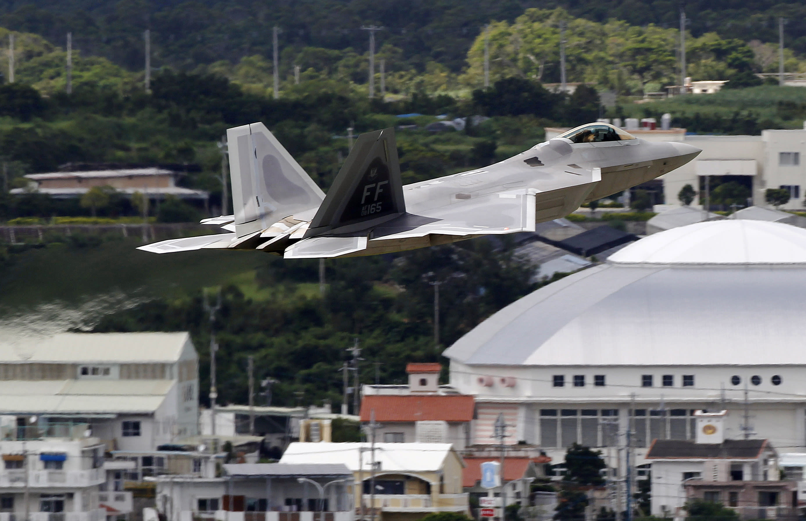 In this Aug. 14, 2012 photo, a U.S. Air Force F-22 Raptor stealth fighter takes off from Kadena Air Base on the southern island of Okinawa in Japan. The U.S. is hoping a dozen F-22 stealth fighters now roaring through the skies of southern Japan will prove its most prized combat aircraft is finally ready to resume full operations after years of investigations into why its pilots were getting dizzy and disoriented. But questions remain over whether the Air Force has taken enough action to fix a potentially bigger problem - the shriveling of programs to test cockpit life support systems after nearly 20 years of budget cuts, downsizing and outsourcing. (AP Photo/Greg Baker)