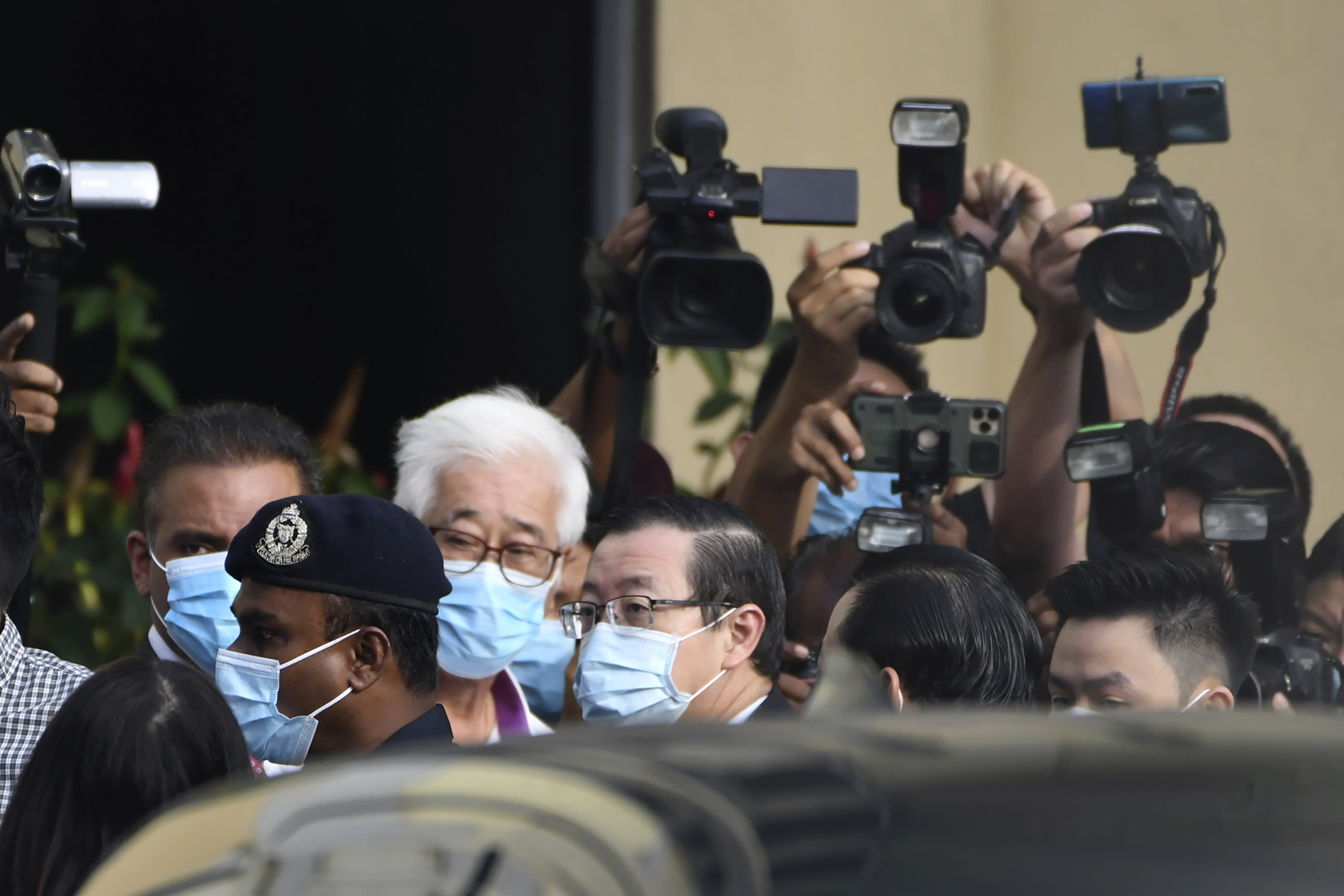 Malaysian former Finance Minister and Penang Chief Minister Lim Guan Eng, center, arrives at courthouse in Butterworth, Malaysia, Monday, Aug. 10, 2020. Lim pleaded not guilty to a second graft charge relating to a $1.5 billion undersea tunnel project. Lim has slammed the charges as political persecution by the new government. (AP Photo/David ST Loh)