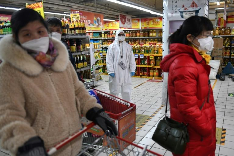 Initially criticised for their slow response to the virus, chastened authorities in China have gone on the offensive in recent weeks (AFP Photo/GREG BAKER)