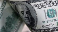 Dollar slams yen and safe-haven status, gold gains