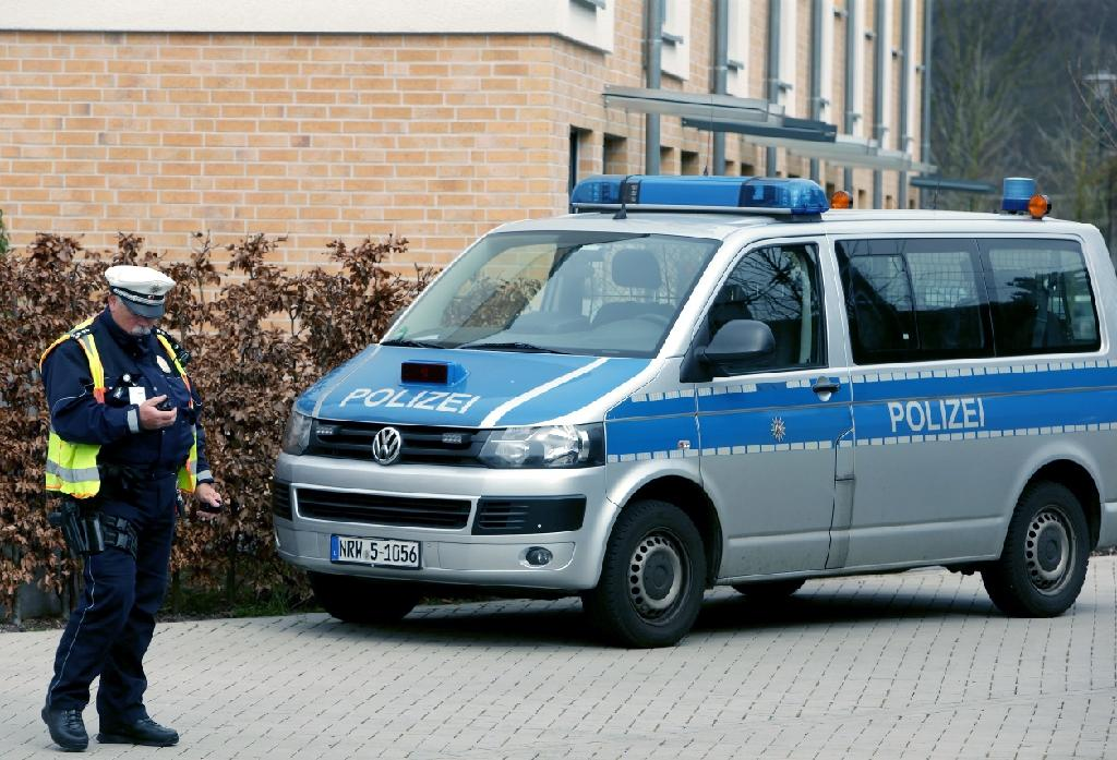 A policeman stands next to a police car in front of a house in Duesseldorf, western Germany, on March 26, 2015, during the investigation into the Germanwings plane crash over the French Alps (AFP Photo/David Young)