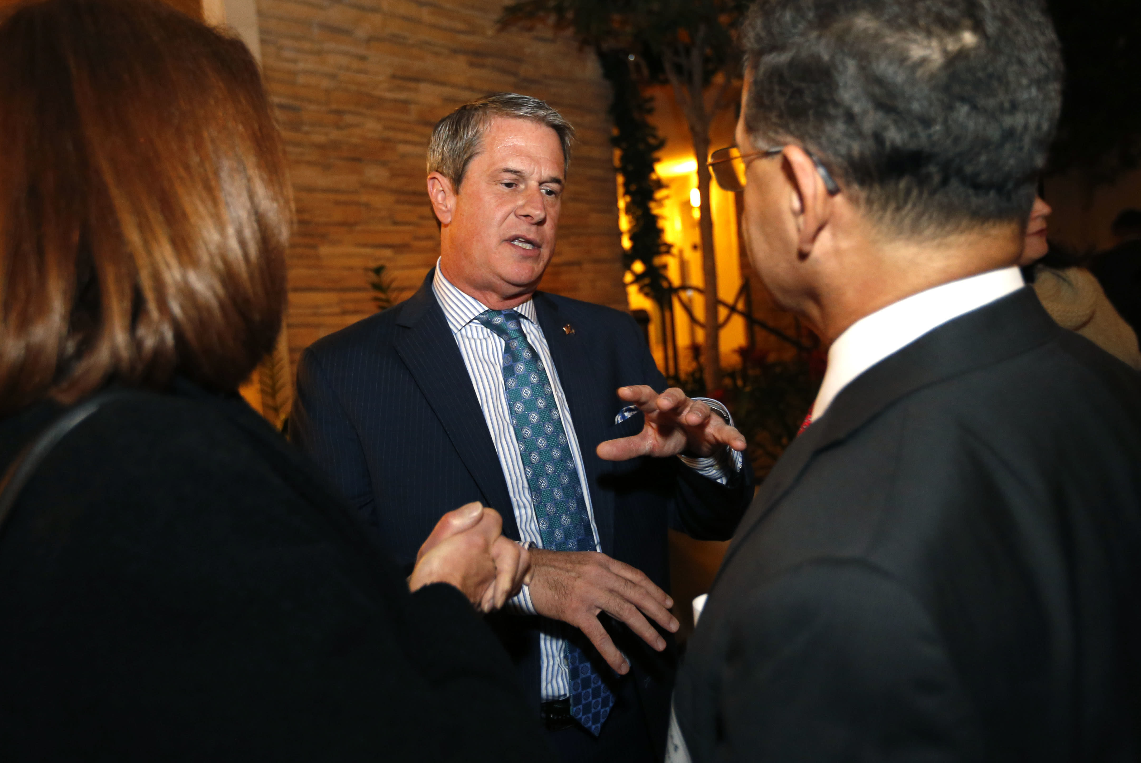 Sen. David Vitter, R-La., talks to supporters of Louisiana state treasurer John Kennedy, at Kennedy's election watch party, in Baton Rouge, La., Saturday, Dec. 10, 2016. Kennedy won the senate seat vacated by Vitter. (AP Photo/Gerald Herbert)