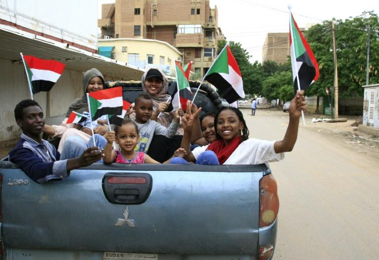 Sudanese children take part in celebrations after protest leaders and generals signed a landmark agreement that will govern Sudan's three-year transition to civilian rule (AFP Photo/Ebrahim HAMID)