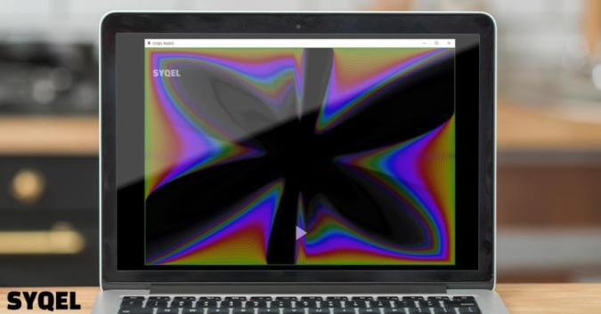 A laptop runs SYQEL software.
