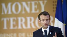 The Latest: Macron hails pledge to fight terror financing