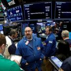 Wall Street mixed as financials drag after Fed rate hike