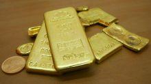 Gold gains on dollar weakness, dovish Fed; palladium sets new record