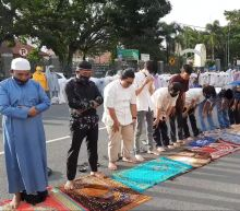 Indonesian Muslims perform Eid prayers with masks