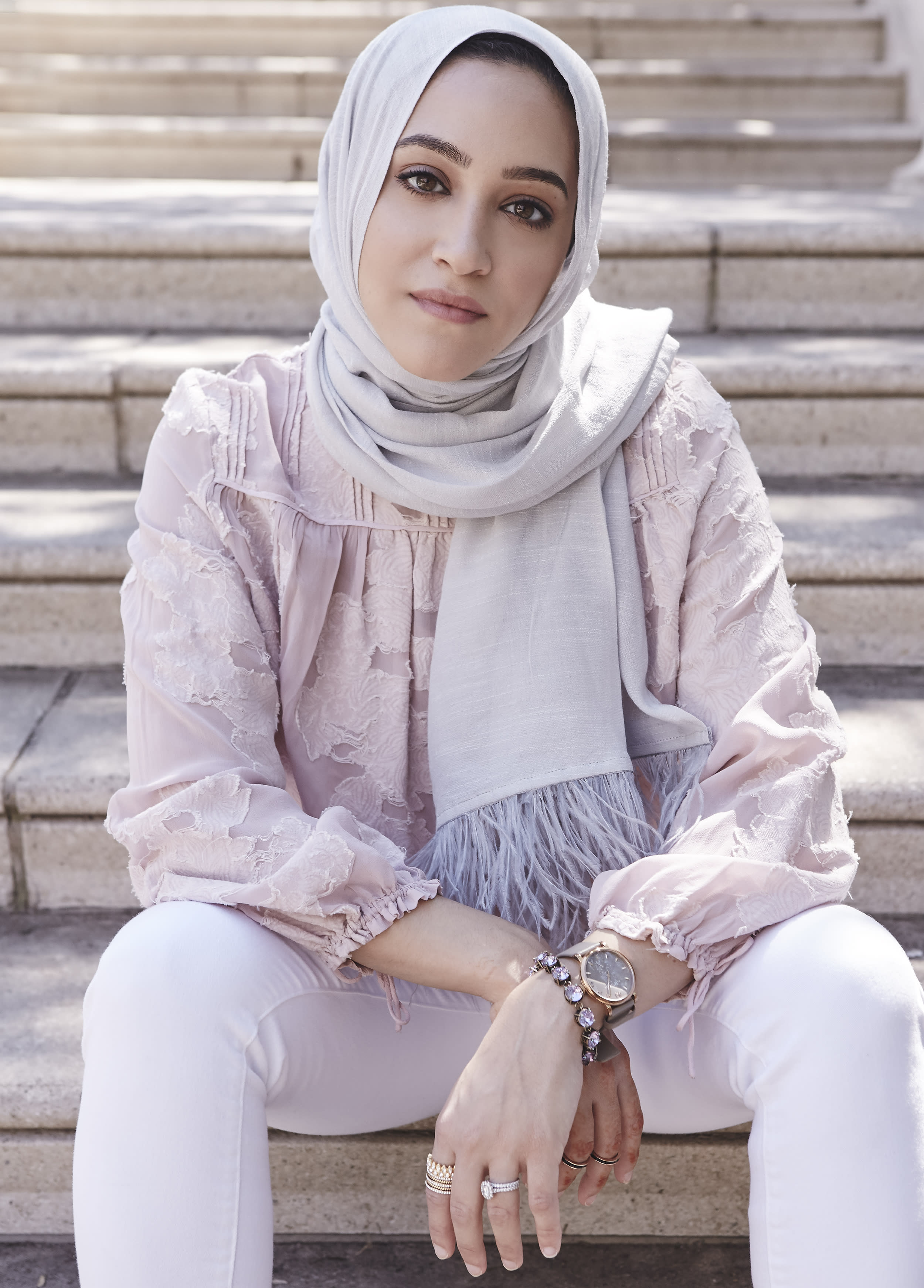 """<p><b>How would you describe your style? </b>My style is classic, but I like to incorporate edgy pieces and trends to keep things modern and relevant. I'm a huge fan of adding a fun hijab like the Framed People feather hijab to pull my look together. I believe fashion is in the eye of the beholder. We're in a world where we get on social media for outfit inspiration and can easily replicate an outfit we saw on a celebrity. This can be a double-edged sword, because while it can solve our dilemma of needing an outfit, we may all end up looking the same and can lose our originality. If there's one thing I live by when it comes to style and fashion, it's to be daring. Challenge yourself and don't be so hard on yourself, because in the end, what matters is feeling beautiful and comfortable.<br>Check out <a href=""""https://www.framedpeople.com/"""" rel=""""nofollow noopener"""" target=""""_blank"""" data-ylk=""""slk:Framed People"""" class=""""link rapid-noclick-resp"""">Framed People</a>.<br>(Photo: Jamie Berg for Yahoo Lifestyle) </p>"""