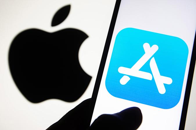 UKRAINE - 2021/09/23: In this photo illustration an App Store icon logo is seen on a smartphone screen with an Apple logo in the background. (Photo Illustration by Pavlo Gonchar/SOPA Images/LightRocket via Getty Images)