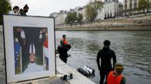 """Climat: action à Paris des """"décrocheurs"""" des portraits de Macron"""
