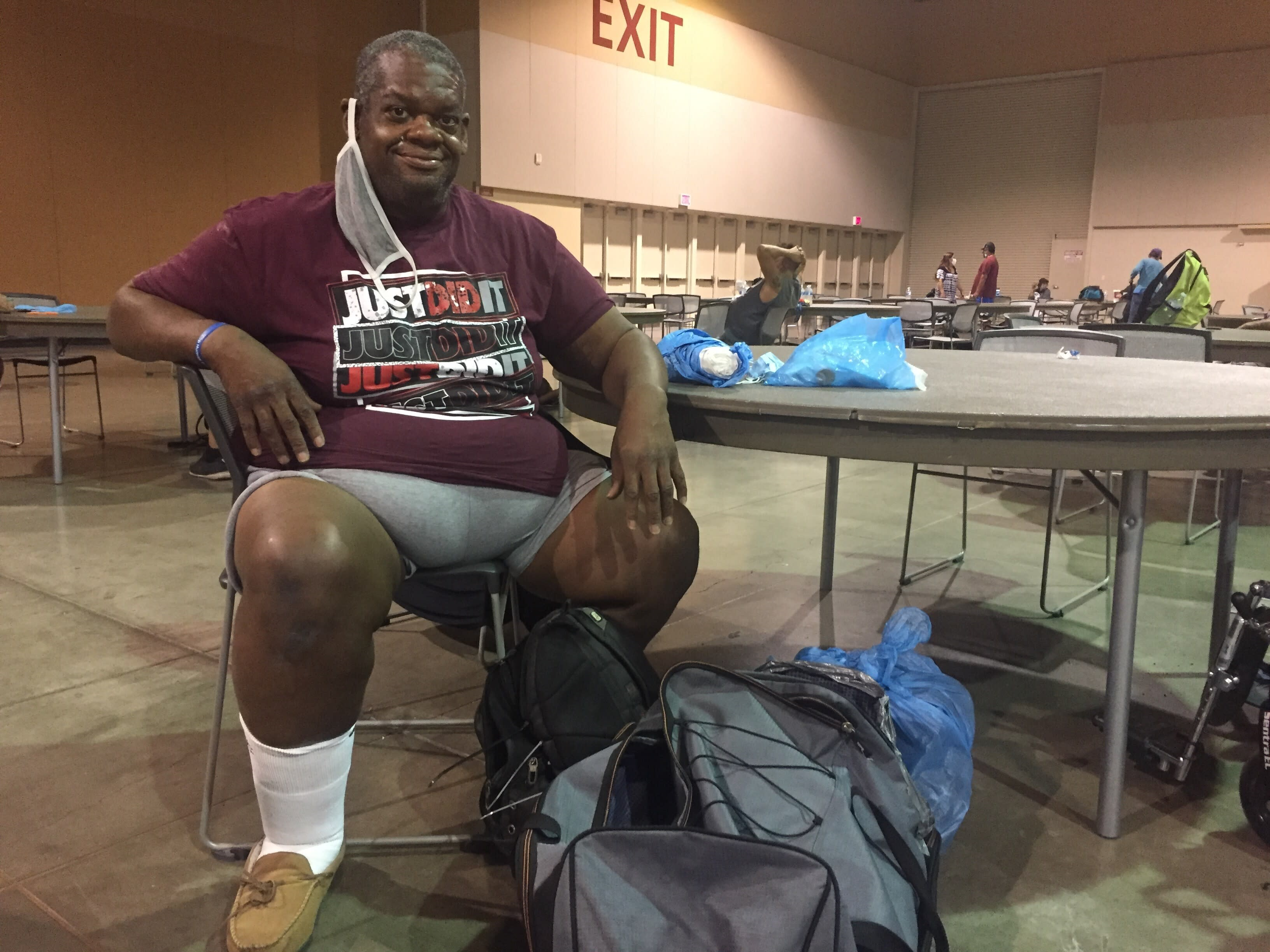 Gary Goodman, 47, rests at the heat respite center at the Phoenix Convention Center on Sept. 1, 2020. Goodman tries to arrive at the center around 9 a.m. and stay until 6 p.m. when he can check into an overnight shelter. (AP Photo/Brian P.D. Hannon)