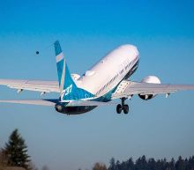 Boeing Sees End Of 737 Max Crisis, Books Massive Charge; Stock Jumps